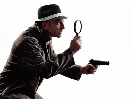 investigating: one detective man criminal investigations investigating crime in silhouette on white background