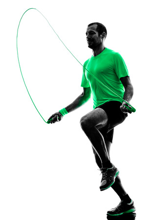 rope: one man exercising jumping rope  fitness  in silhouette isolated on white background