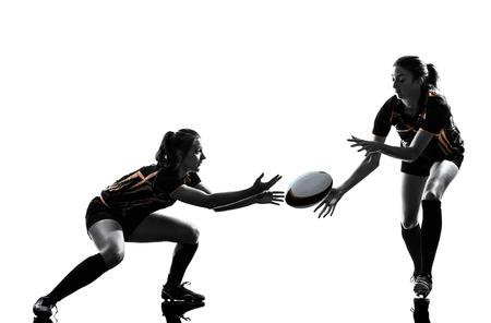 白い背景で隔離のシルエットの女性選手ラグビー
