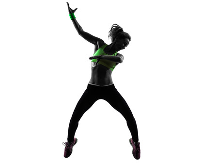 one  woman exercising fitness dancing jumping in silhouette on white background photo