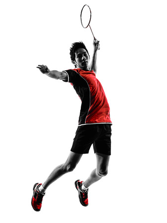 studios: one asian badminton player young man in silhouette isolated white background