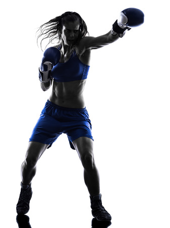 boxer: one woman boxer boxing kickboxing in silhouette isolated on white background Stock Photo