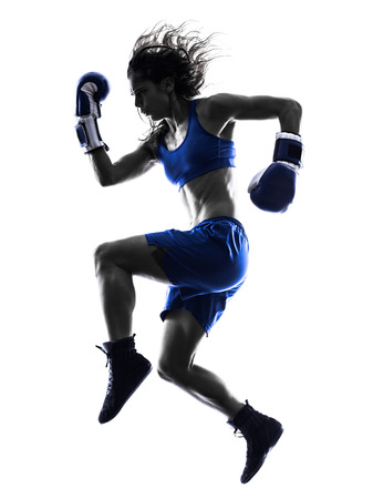 one woman boxer boxing kickboxing in silhouette isolated on white background photo