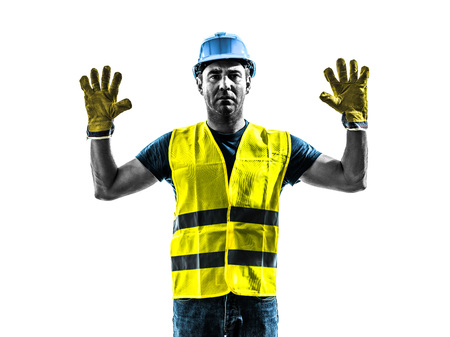 stop gesture: one construction worker stop gesture with safety vest silhouette isolated in white background