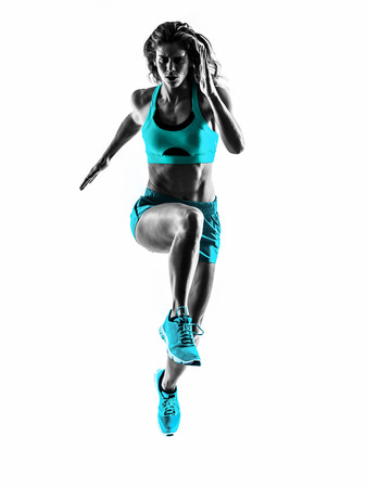 one caucasian woman runner running jogger jogging  in studio silhouette isolated on white background Stockfoto