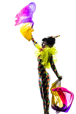 showgirl: one  woman harlequin circus dancer performer in silhouette studio isolated on white background Stock Photo