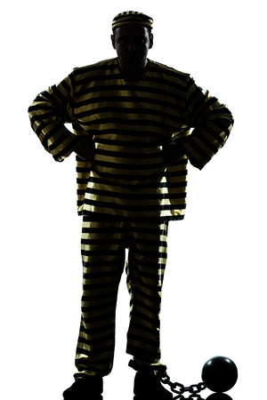jailed: one  man prisoner criminal with chain ball silhouette in studio isolated on white background