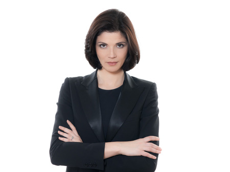 woman serious: one beautiful serious  business woman portrait arms crossed in studio isolated on white background Stock Photo