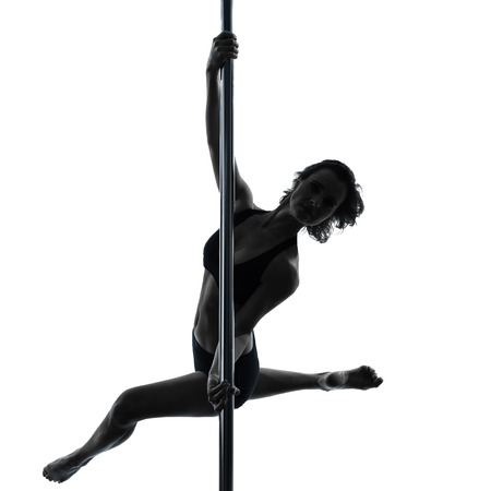 pole dancing: one  woman pole dancer dancing in silhouette studio isolated on white background