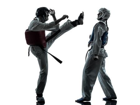 tae: one couple man woman couple exercising karate taekwondo martial arts in silhouette studio isolated on white background