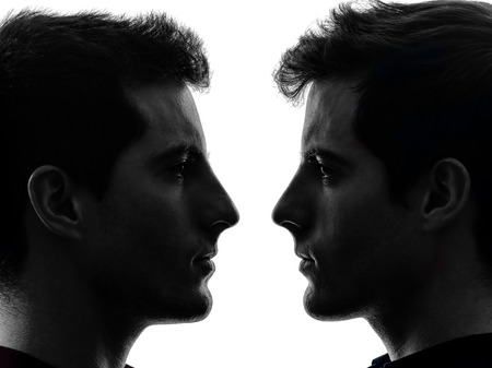 alter ego: close up portrait two  young men in shadow white background