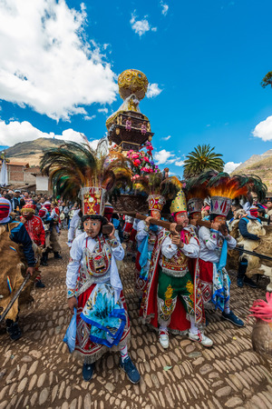 procession: Pisac, Peru - July 16, 2013: Peruvian folklore at Virgen del Carmen parade in the peruvian Andes at Pisac Peru