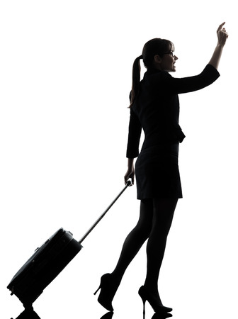 people travelling: one business woman traveler walking hailing silhouette studio isolated on white background Stock Photo