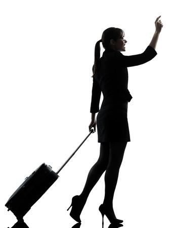 one business woman traveler walking hailing silhouette studio isolated on white background photo