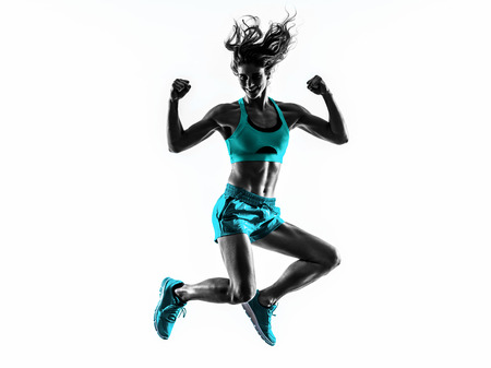 shadow of woman: one caucasian woman exercising  fitness jumping in studio silhouette isolated on white background Stock Photo