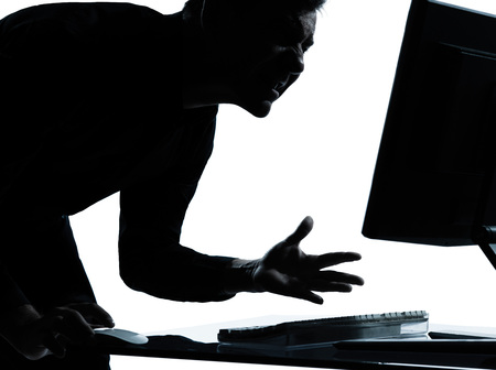 rage: one  business man computing computer angry displeased portrait silhouette in studio isolated on white background