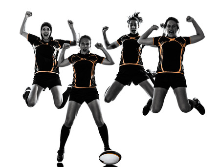 rugby player: rugby women players team celebration in silhouette isolated on white backround