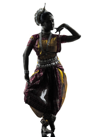 bollywood woman: one indian woman dancer dancing in silhouette studio isolated on white background Stock Photo