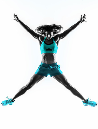 one caucasian woman exercising  fitness  jumping  stretching  in studio silhouette isolated on white background photo