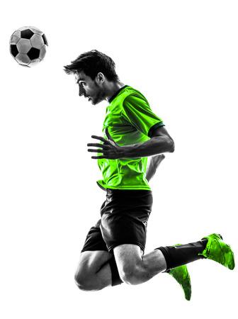흰색 배경에 실루엣 스튜디오에서 한 축구 축구 선수 젊은 남자