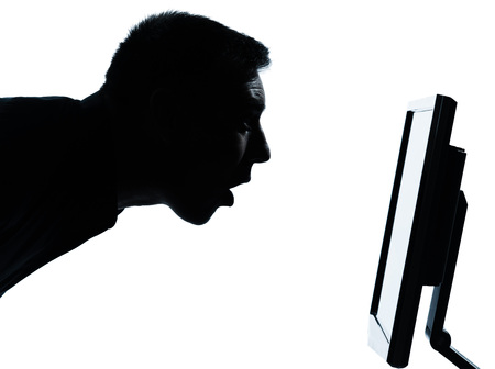 face side: one  business man face silhouette with computer screen display surprised portrait in studio isolated on white background