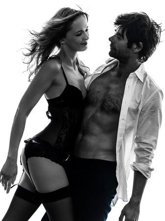 Sexy stijlvolle paar in silhouet op een witte achtergrond Stockfoto - 35651140