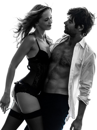 undress: sexy stylish couple  in silhouette on white background