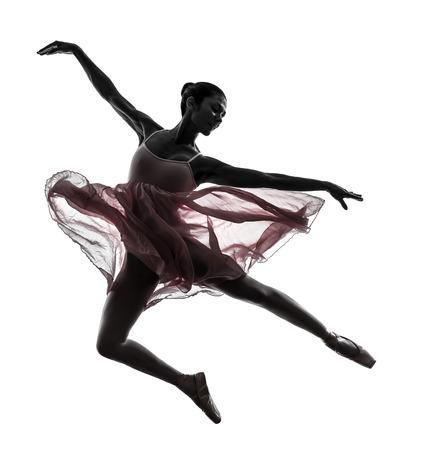 bailarina de ballet: una mujer bailarina de ballet bailarina bailando en silueta sobre fondo blanco Foto de archivo