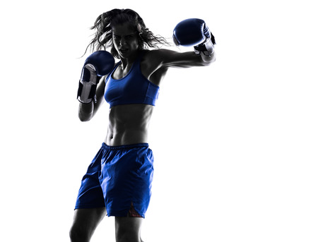 thai arts: one woman boxer boxing kickboxing in silhouette isolated on white background Stock Photo