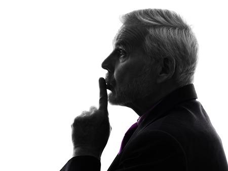 hushing: One Caucasian Senior Business Man hushing finger on lips Silhouette White Background