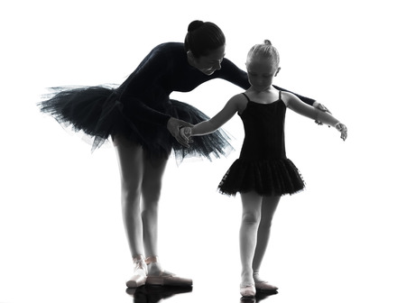 ballet: woman and little girl ballerina ballet dancer dancing in silhouette on white background Stock Photo