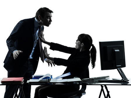 harassment: one  business woman man couple sexual harassment in silhouette studio isolated on white background Stock Photo