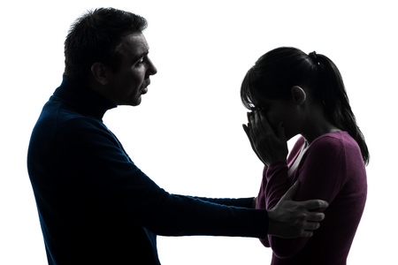 consoling: one  couple woman crying man consoling in silhouette studio isolated on white background Stock Photo
