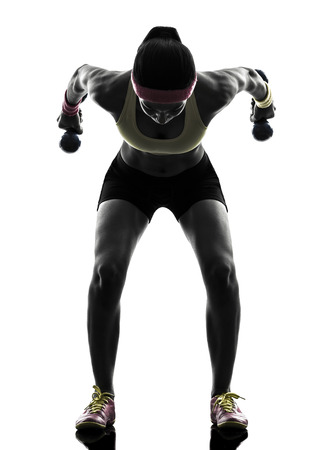 one woman: one woman exercising fitness workout weight training in silhouette on white background