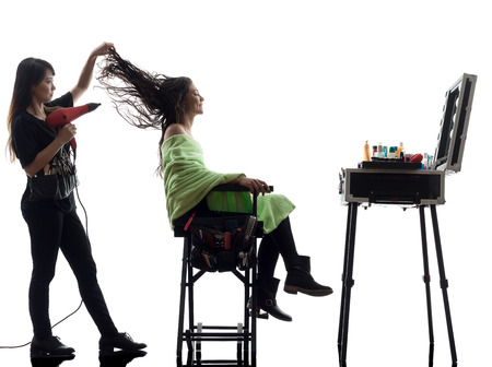 woman and hairdresser in silhouette on white background photo