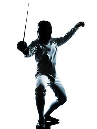 一人の男が白い背景で隔離のスタジオでシルエットをフェンシング 写真素材