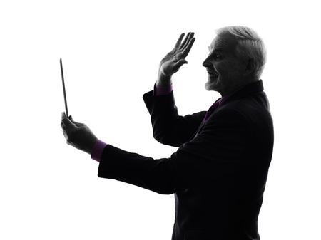 One Caucasian Senior Business Man holding digital tablet saluting Silhouette White Background photo