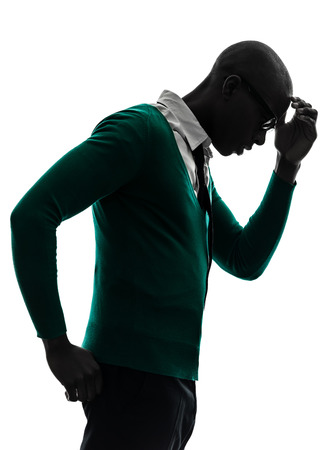 black man thinking: one african black man thinking pensive annoyed in silhouette studio on white background Stock Photo
