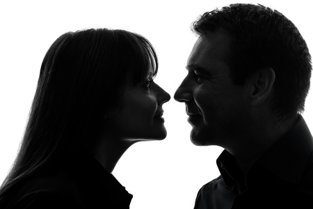 profile views: one  couple woman man in silhouette studio isolated on white background Stock Photo