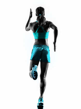 jogger: one caucasian woman runner running jogger jogging rear view in studio silhouette isolated on white background