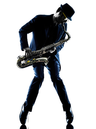 human silhouette: one caucasian man  saxophonist playing saxophone player in studio silhouette isolated on white background