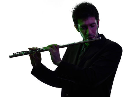 traverse: one caucasian man  playing traverse flute player in studio silhouette isolated on white background Stock Photo
