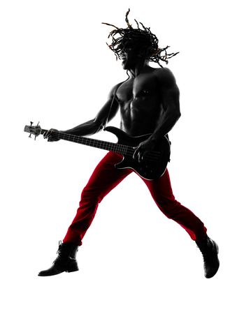 bassist: one african man guitarist bassist player playing in studio silhouette isolated on white background
