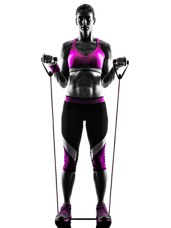 one caucasian woman exercising  fitness resistance bands in studio silhouette isolated on white background Imagens