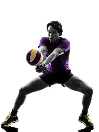 voleibol: jugador joven hombre de voleibol en la silueta de fondo blanco Foto de archivo