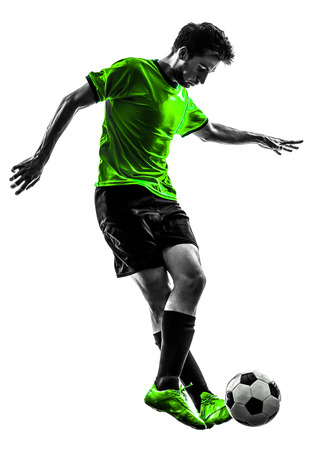 dribbling: one soccer football player young man dribbling in silhouette studio on white background Stock Photo