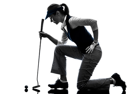 golfing: woman golfer golfing silhouette in white background
