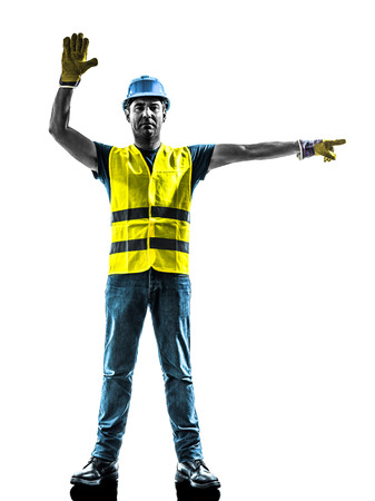 signaling: one construction worker stop gesture detour silhouette isolated in white background