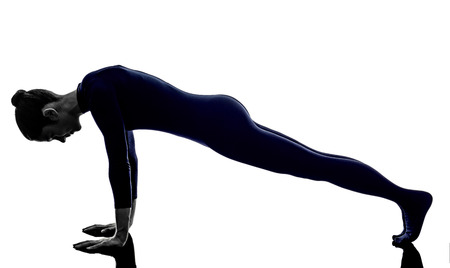 woman exercising dandasana plank pose yoga silhouette shadow white background