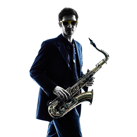 saxophonist: one caucasian man  saxophonist playing saxophone player in studio silhouette isolated on white background